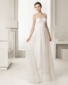 Simple illlusion neckline - Long tulle wedding dress with hemstitch detail. Rosa Clará 2015 Collection.