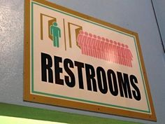 Low Cognitive Effort: this funny, and usually true, restroom sign indicates not only the location of the restrooms, but also the fact that the women's line is always significantly longer than the men's.