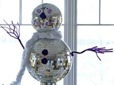 Create a retro Christmas with a disco ball snowman. >> http://www.diynetwork.com/decorating/how-to-make-retro-christmas-decorations/pictures/index.html?soc=pinterest