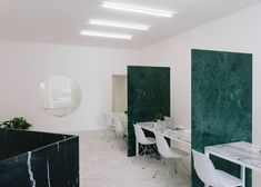 Estate agents featuring partitions and furniture made from various types of marble.