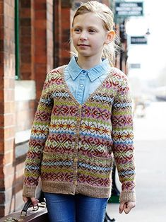 Lucy from Once Upon a Time by Marie Wallin 16 handknit designs for children aged 2 to 10 years. Once Upon a Time is a celebration of British traditional handknits with a hint of crochet. Inspired by the vintage patterning of the 1940's and 1950's, these modern and classic fit garments are perfect projects for mums and grandmas alike and fun for kids to wear too | English Yarns