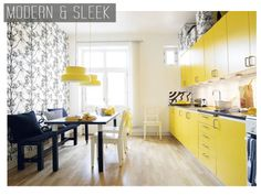Modern and sleek black, yellow and white kitchen.