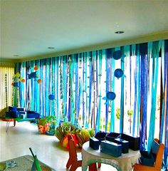 something like this along the windows on both or either side of the room.  and add Lindsey's ocean balloon animals