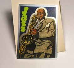 This is a rare vintage 1987 foil vending machine sticker with an illustration of a jazz tenor sax player doing his thing (could be Charlie
