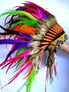 Iris Colorful Feather Headdress by THEWORLDOFFEATHERS on Etsy, $90.00 - I want this with EL wire lighting up the feathers.  Yes, I know this is cultural appropriation, but it doesn't make me want it any less. Unlike others who buy these headdresses, I actually understand that its actually called a war bonnet and I fully understand and appreciate the meaning.