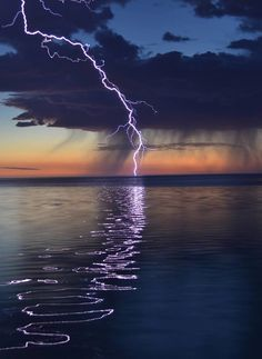 "opticcultvre: ""  Surreal lightning over the ocean """