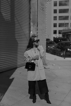 Fiona Dinkelbach from thedashingrider.com wears a camel oversized blazer by HALSTON HERITAGE, black ZARA culottes, a black velvet COCCINELLE arlettis bag, CÉLINE Caty sunglasses in Havana, BALENCIAGA inspired knife boots by MANGO and golden JANE KOENIG earrings   Style Blogger   Location: Brooklyn, New York City   The Dashing Rider   Outfit   Minimalist Outfit   Simple Fall Style   Black Outfit Idea   NYFW Style   NYFW Outfit   Streetstyle