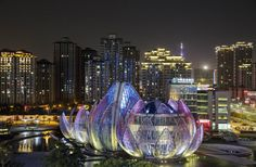 An Australian architecture firm recently unveiled what may be the single coolest-looking municipal facility on the planet — the stunning Lotus Building in the city of Wujin, China.  Officially titled the Lotus Building and People's Park, the 3.5-hectare site features three connected buildings, each representing the lotus flower in different stages of bloom. The landmark structure rises out of an artificial lake in the center of the city, giving the appearance of a flower on a pond.