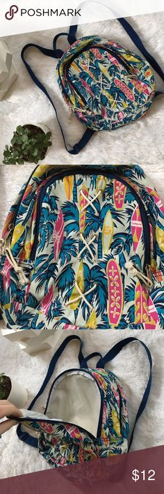 Mini Backpack Tropical Print Bag Small tropical print EastSport backpack with adjustable straps! Two large compartments, the bigger one also has a zipper pouch at the top. Only some tiny marks on the inside big pocket as shown. Unique and trendy! Great for summer adventures. Bags Backpacks
