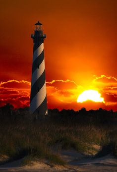 """Cape Hatteras Lighthouse at Sunrise"" by James Hilliard...we were there when it was moved, due to beach erosion, to its present location...amazing"
