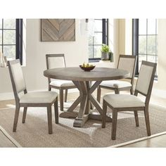 The beautiful Molly dining set from Steve Silver features a round standard height table and 4 upholstered side chairs in a contemporary lodge styling that creates a grand statement in a cozy dining table. Tiny Dining Rooms, Round Dining Room Sets, Luxury Dining Room, Square Dining Tables, Dining Table In Kitchen, Dining Room Design, Dining Room Furniture, Outdoor Furniture, Furniture Storage