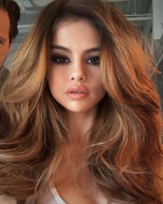big wavy hair, smokey eyes make up, nude lips lipstick, hairstyle, long hair