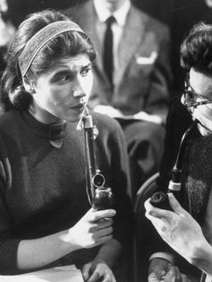 Woman Smoking Pipe at Pipe Smoking Contest