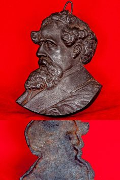 """This is an intriguing item by today's standards – would we seek to put the image of a current writer on our wall? I love books, I love reading but I think I would draw the line at having a cast metal (probably iron) portrait of an author on the wall. For this offering the author is Charles Dickens and the likeness is a well-recognised one. No makers name seen. The plaque is 7"""" (179mm) deep and has a maximum width of 5 ½"""" (140mm)."""