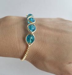 This delicate set of earrings and bracelet has been beautifully wrapped with a non tarnish wire and blue crystals to give you that pop of color, casual or semi formal this set will look great on you any time of the year! This handmade wire wrapped set it going to look amazing on you. Its
