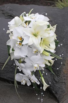 Wedding Oriental bouquet made of white Casalanca lilies.  These lilies have larger blooms than Asiatic Lilies and a very sweet scent.