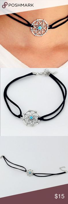 "Trendy Boho Choker & Hipster Dream Catcher Charm Trendy Boho Dream Catcher Choker! Chokers are the must have IT piece and this one is very special!! Wear it and surround yourself with positive energy and good vibes! You will love this cool choker! Material: Vegan Leater, silver plated zinc alloy, faux turquoise stone, dream catcher about 1"", choker adjustable between 13-15"" Jewelry Necklaces"