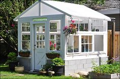 Building a green house using vintage windows The completed greenhouse