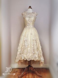 Flower embellished bodice of the 'Fayette' dipped hem wedding dress by Joanne Fleming Design
