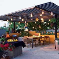 """Summer lights idea from Sunset Magazine   In his backyard ramada in Scottsdale, Arizona, artist Jeff Zischke houses candles in antique carriage lamps and ordinary mason jars; he supplements their glow with low-voltage lamps.""""There's still no substitute for candlelight,"""" he says. """"That flickering glow just draws people in like moths."""""""