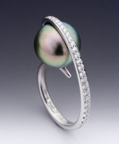 Black Pearl Ring by Etienne Perret. With a white/cream pearl would be amazing.