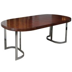 """polished chrome dining table: 29.75"""" h x 42"""" d x 72"""" w at max"""