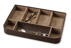 This stackable leather accessory tray is a handsome receptacle for the contents of his pockets.