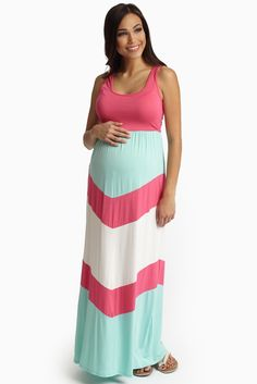 The most vibrant, playful hues come together in this chevron printed bottom maxi dress for the ultimate summer essential. Pink-Chevron-Printed-Bottom-Maternity-Maxi-Dress