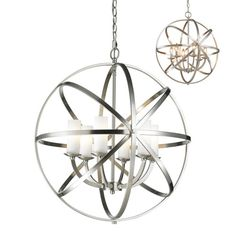 Z-Lite Aranya globe chandelier. Orbiting metal bands circle the contemporary inner chandelier. This family is made up of round and oval shapes finished in brushed nickel and complimented with matte opal glass. Globe Chandelier, Glass Bulbs, Candle Globes, Filament Design, Bronze, Light, Pendant Lighting, Cage Chandelier, Globe Lights