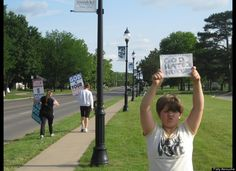 """9 year-old counter-protests Westboro Baptist Church with sign that reads """"God Hates No One"""""""