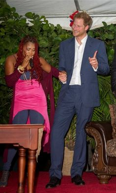 Shake it in the island sun! Prince Harry took the stage to show off his dance moves next to soca singer Claudette Peters during the reception hosted in his honor by the Prime Minister of Antigua and Barbuda, Gaston Browne.