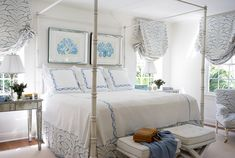 Amazing light blue and white bedroom with Talavera Brunschwig & Fils fabric and coral prints