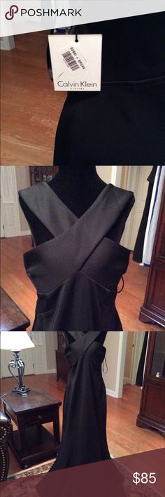 "Black Calvin Klein Formal Dress Size 14 NWT Black Calvin Klein Formal Dress Size 14 NWT  - the dress is considered a 'scuba' dress but it really feels like really nice heavy fabric. It flows beautifully. I am 5'8"" and it would work with 2-3"" heels on me. The fabric does have some stretch and had a nice built in bra. Really lovely dress Calvin Klein Dresses Maxi"