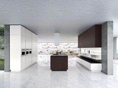 Top 10 modern kitchen designs. Something of an elaborate and very unusual kitchen, the cupboards, cabinets and appliances are all covered in white brushed steel to match the floors.