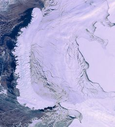https://flic.kr/p/dPv9i1 | Novaya Zemlya archipelago, Arctic Circle | This Envisat image from 19 March 2012 shows the elongated islands of the Novaya Zemlya archipelago on the left, the mainland of northwestern Russia to the right and an ice-covered Kara Sea in the centre. The Barents Sea is off the islands' west coast. Located completely within the Arctic Circle, Novaya Zemlya is an extension of the Ural Mountains.   The Arctic's hard environment makes it difficult to explore. Today…