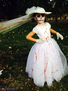 Naomi: Kaylee age 6 wearing a brides costume she wanted to wear a big dress and wanted to look scary costume was bought for a total of $11 face painting was...
