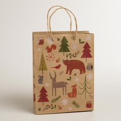 Medium Woodland Animals Kraft Gift Bag | World Market Christmas Gift Bags, Christmas Snacks, Christmas Is Coming, Christmas Wrapping, Holiday Gifts, Christmas Cards, Holiday Decor, Xmas, Woodland Creatures
