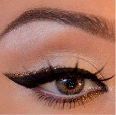 A swoop of gold to accent a cat eye for the holidays.