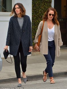 Blazing ahead: The actresses were similarly dressed in dark trousers with oversized blazer...