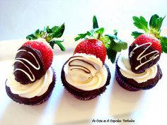 Cupcakes with chocolate covered strawberries on top!