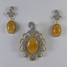 Buy Yellow Pendant Set With White Stones at haveaclick.com