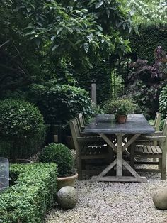 Evergreens bring a sense of calm and shade to this country-style dining area #gardendesign