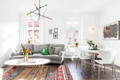 Beautiful light & great design classics in an apartment for sale in Linnéstaden, Gothenburg   Photo by Anders Bergstedt for Swedish broker Lundin Fastighetsbyrå   via Style and Create