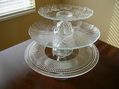 Make glass cake stands from the Dollar Store. Cute idea.