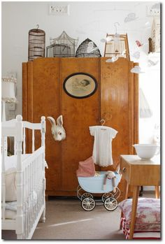 It's a nursery, but the birdcage collection atop the amoire and the picture hanging on the front can used anywhere.  Elle Decoration