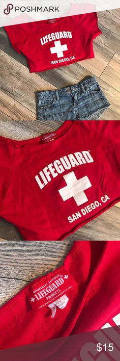 Lifeguard crop top Sooooo cute right?! Great condition. The plastic hanger straps did come off but otherwise good  please note the cover shot has a different beach location then the actual piece for sale! The sale shirt says SAN DIEGO  just wanted to show the cover shot so you can see how it would fit! lifeguard Tops Crop Tops
