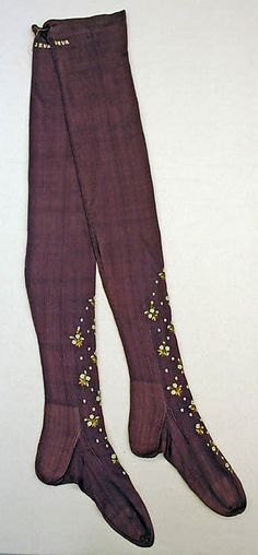 board of random antique clothing  early 20th Century French Silk Stockings  Met museum C.I.53.60.6a, b