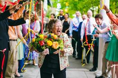 """This 88-year-old grandmother of the bride bombed the couple's ribbon exit by walking out first and then proceeding to dance through the twirling ribbons with one of the centerpieces."""