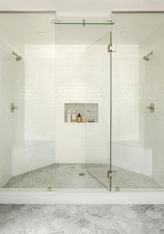 Marble hex floor tiles lead to a seamless glass shower fitted with mosaic marble floor tiles and his and hers corner benches mounted against polished nickel shower kits. Tub To Shower Remodel, Bath Remodel, Diy Shower, Shower Kits, Shower Ideas, Bathtub Shower, Shower Installation, Glass Shower Enclosures, Bathroom Pictures