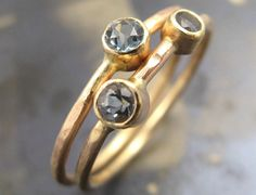 Raw diamond stacking rings. Worn alone or together, amazing.